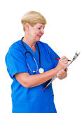 Nurse writing on clipboard Royalty Free Stock Photo