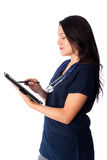 Nurse writing digital patient chart Royalty Free Stock Photography
