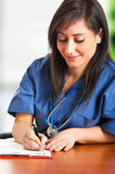 Nurse writing prescription Stock Images