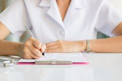 Nurse writing report in hospital. To work Stock Photography