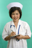Nurse writing and smiling Royalty Free Stock Images