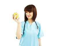 Nurse or young doctor with apple, smiling Royalty Free Stock Photo