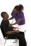 NurseChecking Heart Stock Photos