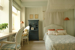 Nursery. Elegant nursery with double window and chairs Stock Photography