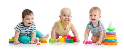 Nursery babies playing with toys isolated on white background royalty free stock photo