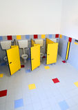 Nursery bathrooms with doors of cabins Royalty Free Stock Image