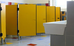 Nursery bathrooms with yellow doors of cabins Stock Images