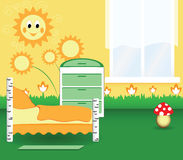Nursery bedroom. With the orange flowers and the toy Stock Image