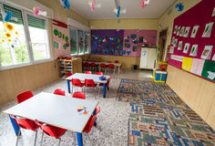 Nursery class with tables and small red chairs Royalty Free Stock Image
