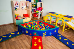 Nursery with colorful toys and balls Stock Image