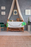 Nursery with a crib. Spacious nursery with a crib and suitcase under the crib stock photos