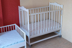 The nursery has two Cribs. One cot for toddlers and one for older children. Crib white. On the mattresses in the covers Royalty Free Stock Photography