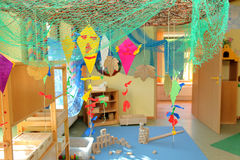 Nursery or kindergarten. Colorful children's room or nursery with toys and craft work Stock Photos