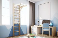 Baby boy s room with a computer, a ladder. Nursery with a mountain wallpaper, a wooden floor, a double bed with a house like roof, a computer desk and a ladder Royalty Free Stock Photo