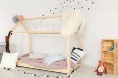 Nursery with polka dots wallpaper. Dreamy modern and minimalistic nursery with polka dots wallpaper stock image
