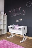 Nursery room with chalkboard wall. White nursery room with blackboard paint on the wall stock images