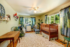 Nursery room with crib and old bed. Nursery room in old house in light green tone royalty free stock images