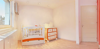 Nursery room interior. Newly decorated for newborn baby royalty free stock photography