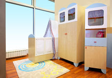 Nursery room. Modern nursery room interior with baby crib stock image
