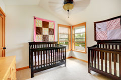 Nursery room with two cribs stock image
