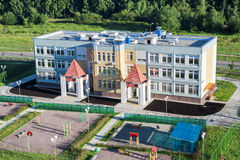 Nursery school building with playgrounds Royalty Free Stock Image