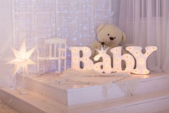 Nursery with soft toys and an inscription of baby Stock Images