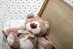 Nursery with a toy teddy bear in a suitcase Stock Image