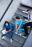 Nurses and doctor talking on stairs Stock Image