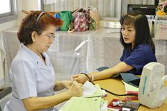 Nurses are measuring the pressure to the sick,thailand Royalty Free Stock Photo
