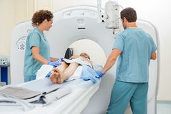 Nurses Preparing Patient For CT Scan Royalty Free Stock Photos