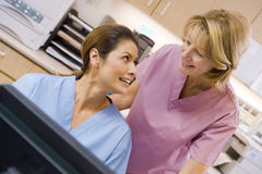 Nurses At The Reception Area Of A Hospital Stock Image