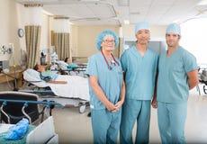 Nurses Standing In Hospital Ward. Portrait of multiethnic nurses standing in hospital ward Royalty Free Stock Image