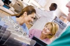Nurses Talking At The Reception Area In A Hospital Stock Photography