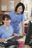 Nurses Using Computer At Clinic Stock Photos