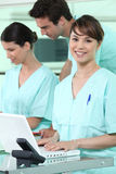 Nurses using a computer Stock Photo