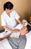 Nurses wash a patient Stock Image