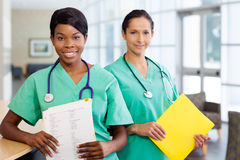 Nurses at work station Stock Photo
