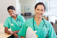 Nurses at work station Stock Photography