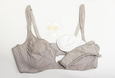 Nursing bra for mothers and Silicon nipples. moms bra with new disposable breast pad. Prevents the flow of milk on the clothes, it Stock Photos