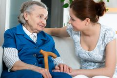 Nursing home. Senior woman with her home caregiver stock image
