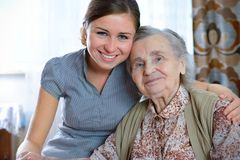 Nursing home. Senior woman with her home caregiver stock photography