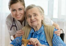 Nursing home. Senior woman with her home caregiver royalty free stock photography