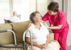 Nursing Home Care. Senior woman in a nursing home, with a caring nurse stock photos