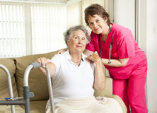 Nursing Home Care. Friendly nurse cares for an elderly woman in a nursing home Royalty Free Stock Photography