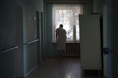 The nursing home. Elderly man looking out the window Stock Photography