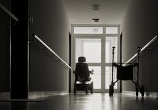 Nursing home. Lonely corridor with walker in a nursing home royalty free stock image