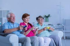 Nursing home residents playing games Stock Photos