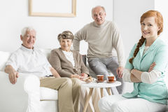 Nursing home with seniors. Comfortable nursing home with smiled seniors Royalty Free Stock Photos