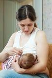 Nursing little baby Stock Images