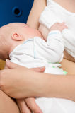 Nursing newborn Stock Photo